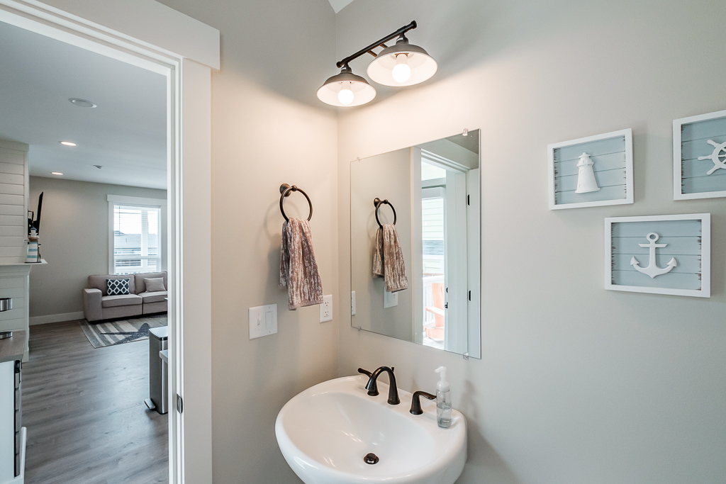 A beautiful bathroom for guests, just off the kitchen and adjacent side-door to deck.