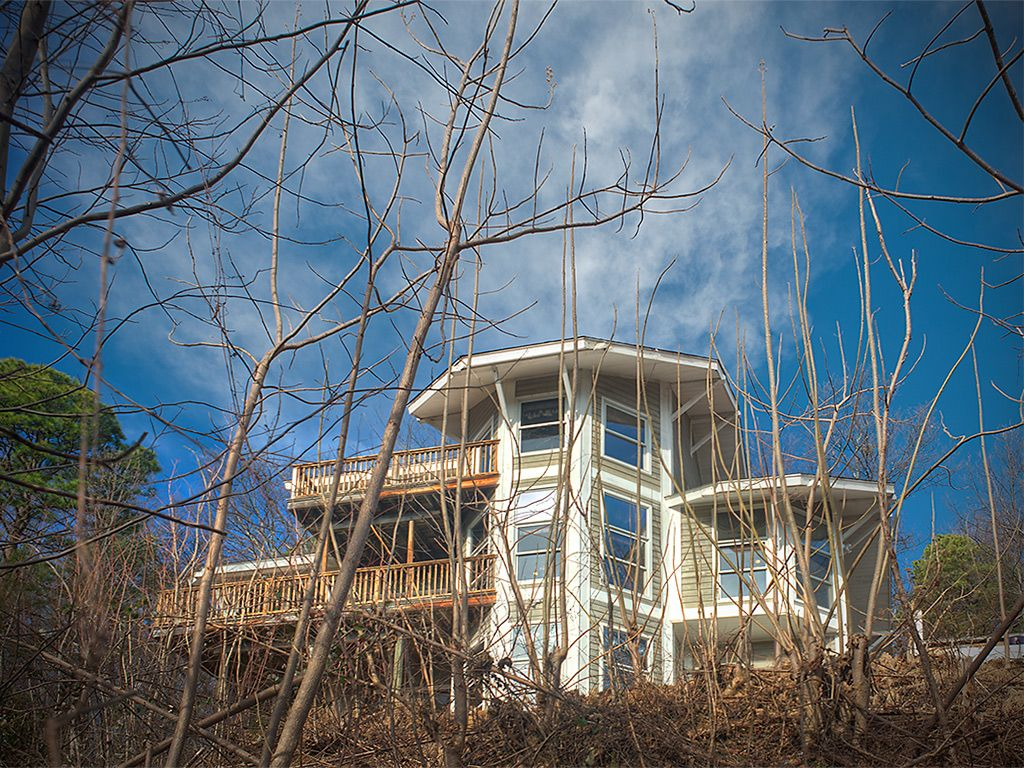 Front of home that faces the mountains. Wonderful views from 2d & 3d floor decks