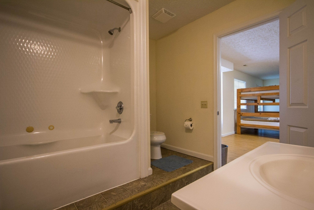 Full bathroom next to bunk rooms