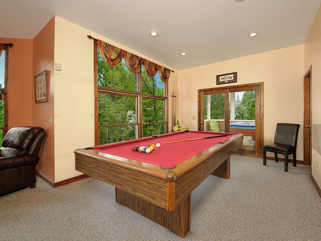 Pool table in game room and hot tub on screened porch. first floor