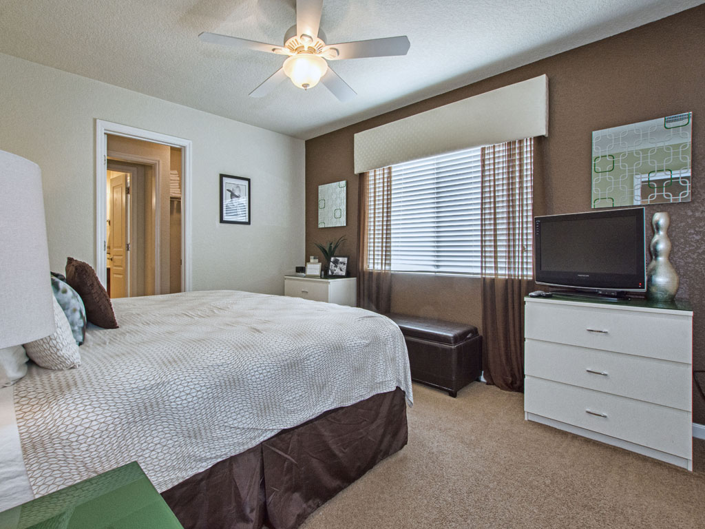 Large king sized bed and tv for the third upstairs bedroom.
