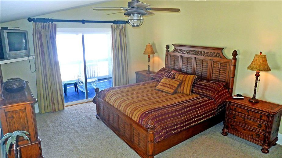 Master with king bed and private door to ocean front porch!