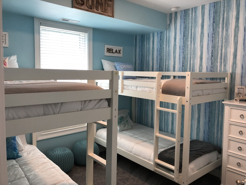 Dual bunk beds with calming decor. Great for the kids to gather / sleep!