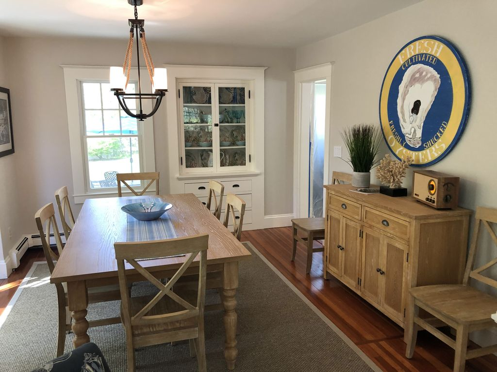 Dining room adjacent to kitchen with seating for eight.
