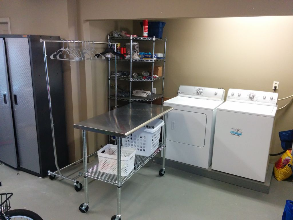 spacious 1st floor storage area with enclosed washer/dryer...very convenient!