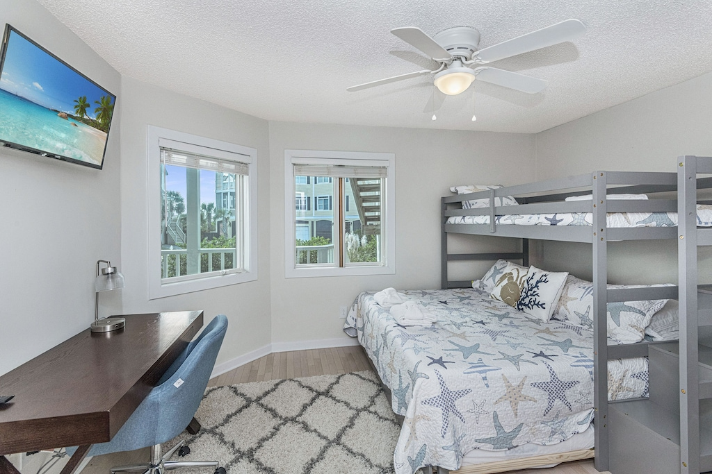Bedroom with workstation and views of front porch and beach