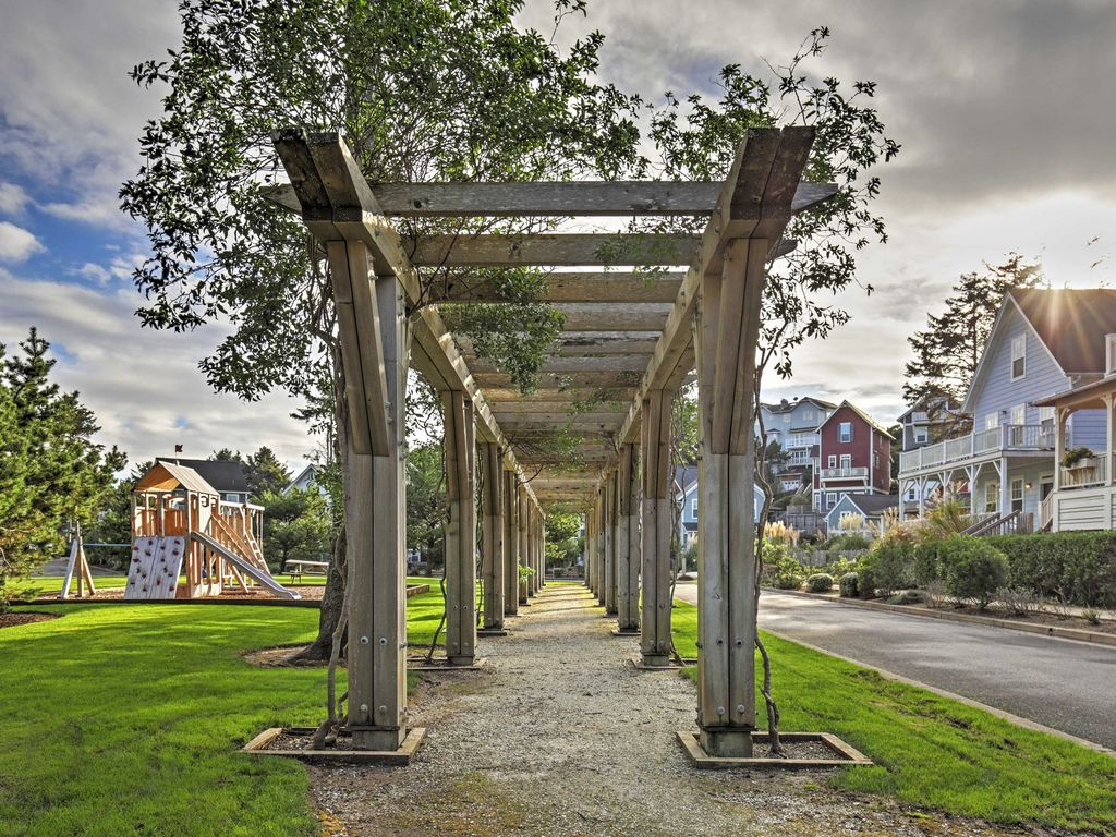 One of two play structures in the Olivia Beach community, with trellises bordering the park.