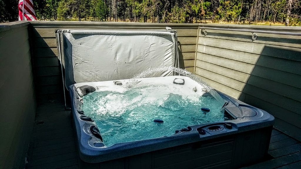 Professionally maintained hot tub seats 8.