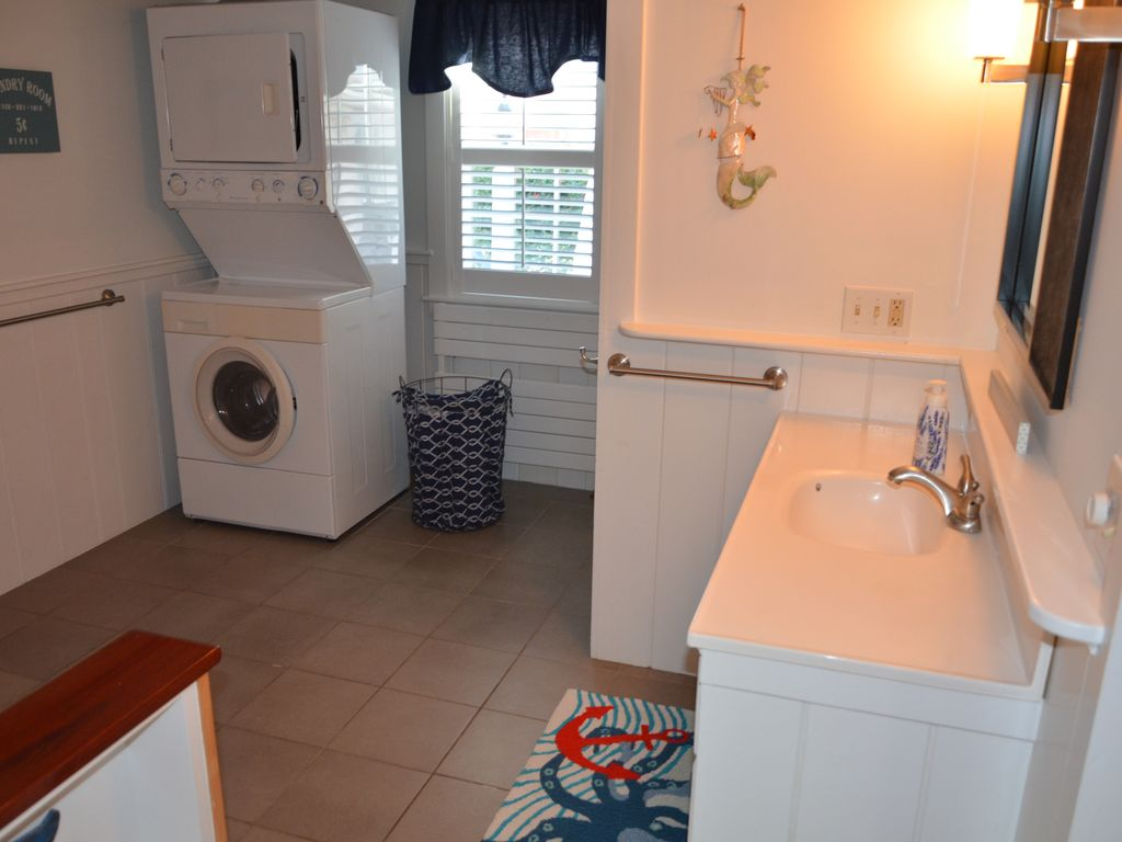 Stackable washer & dryer located in the combination 1st floor bath/laundry room.