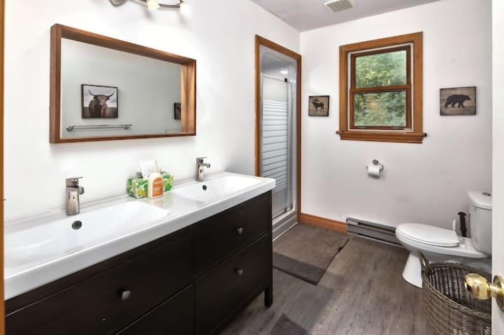 Main floor washroom has lots of room with two sinks
