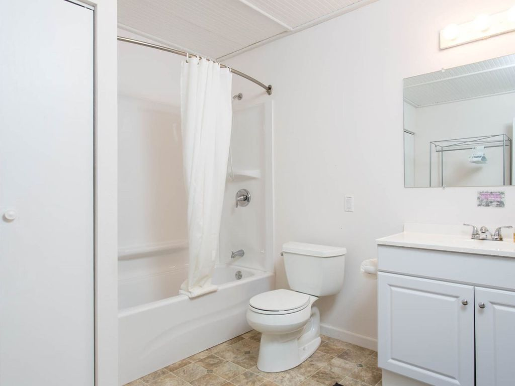 The lower level full bath - the washer and dryer are tucked away in the closet.