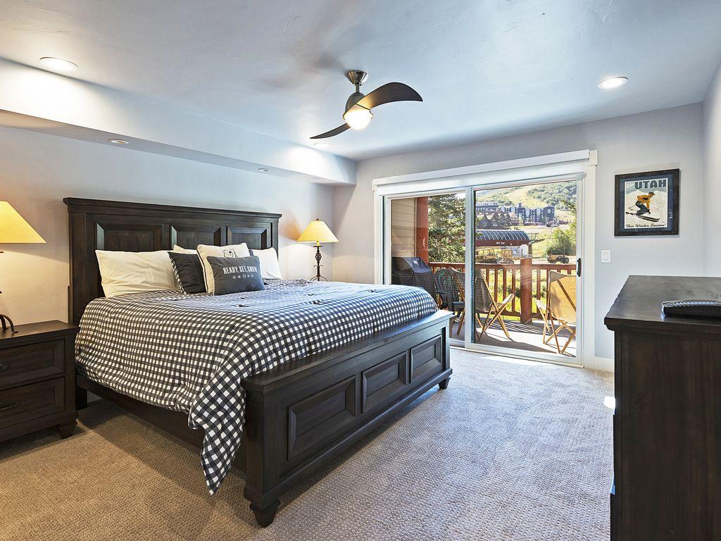 Master ensuite bedroom.  King Bed, deck to slopes