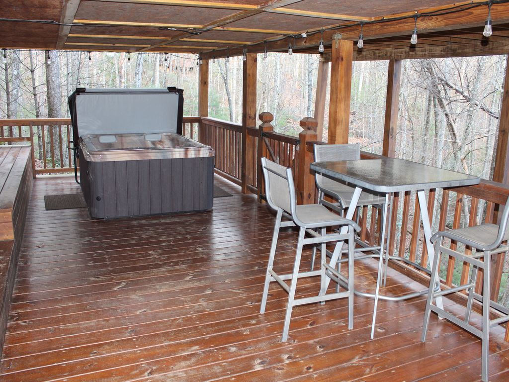 Hot tub is located on the lower deck accessible from outside of cabin
