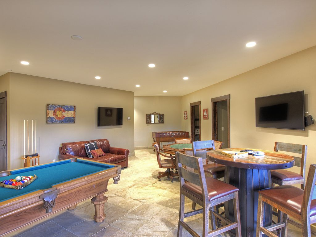 Game Room - Pool table, foosball and poker table.  Three, 4k High def tv.