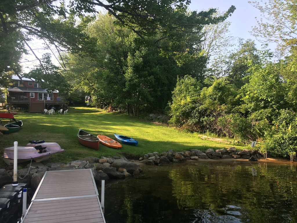 Cottage lawn showing various water craft