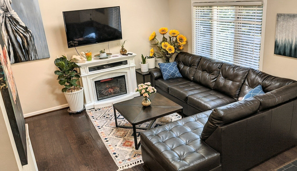 Modern open floor plan with comfortable couches and large TVs