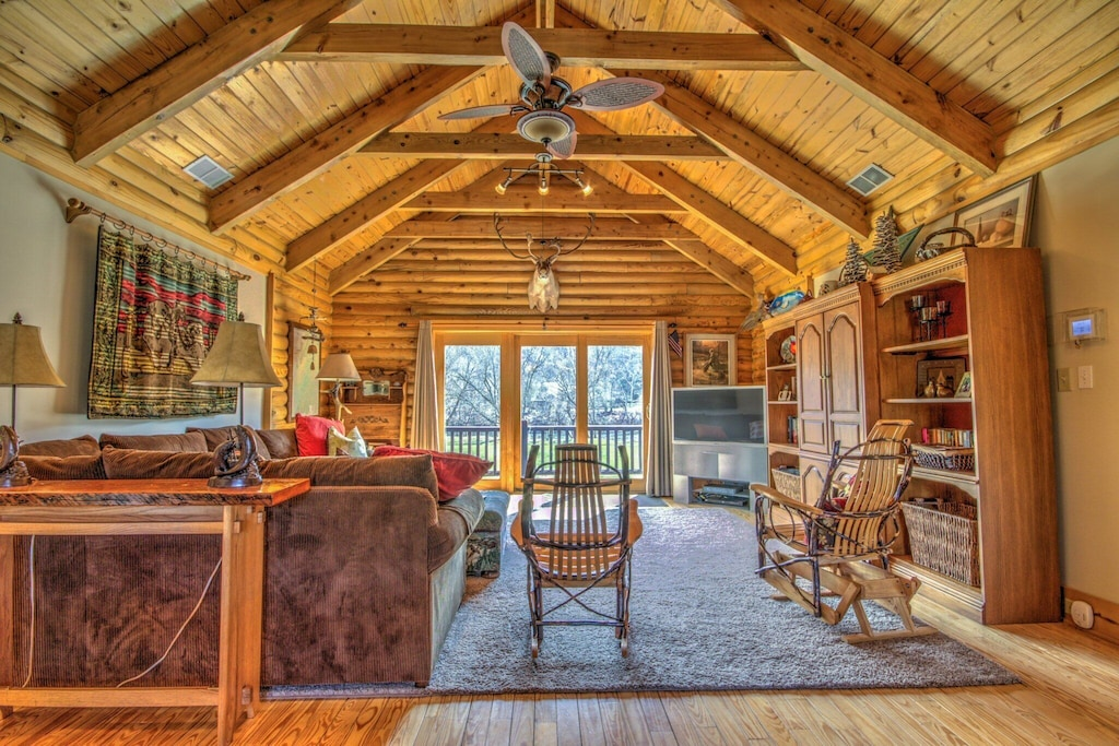 Open cabin floor plan with warm comfy fixtures and decor