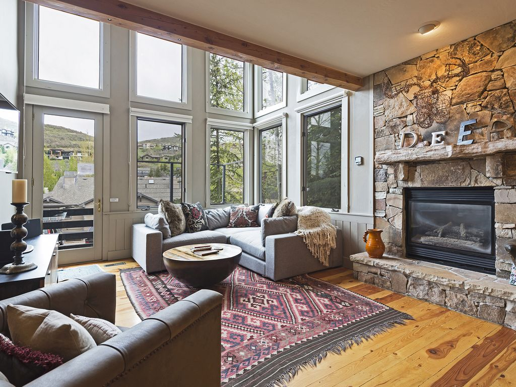 """Living area with private deck, fireplace, 72"""" smartTV"""