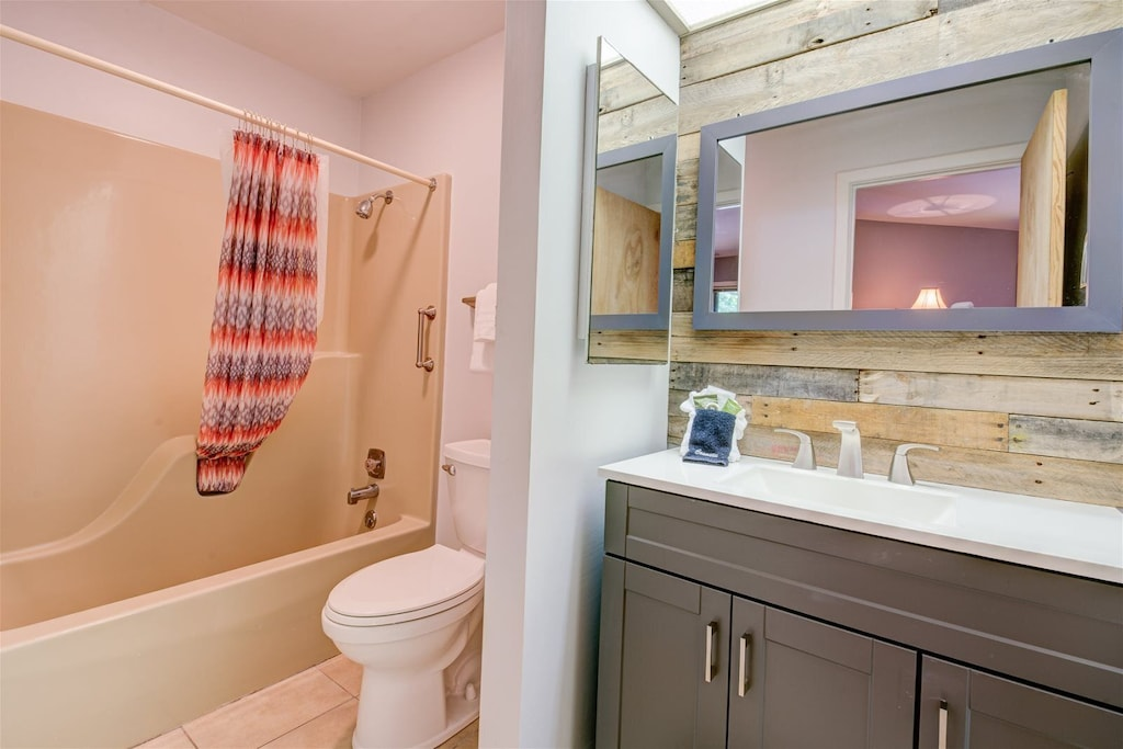 Bathroom with a combination shower-tub