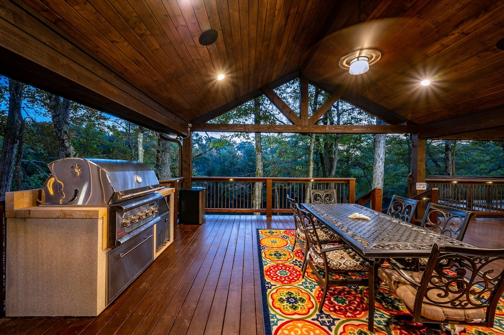Professional grade propane grill and outdoor eating area, both with river views.