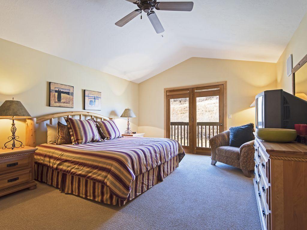 master bedroom.  King size bed, patio/balcony