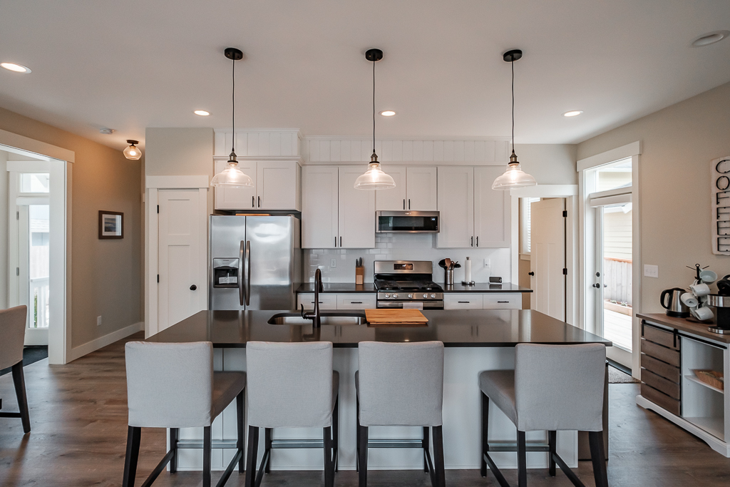Fully-outfitted kitchen, with island seating and spacious storage.