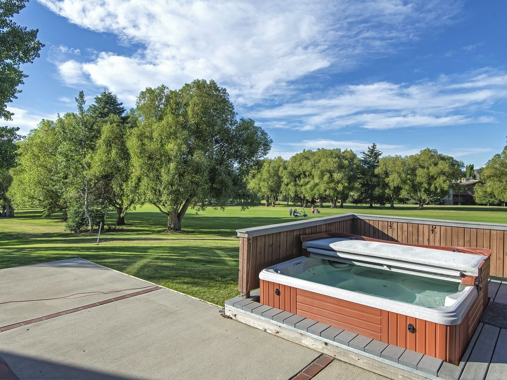 large deck with private hot-tub that looks over Park City municipal