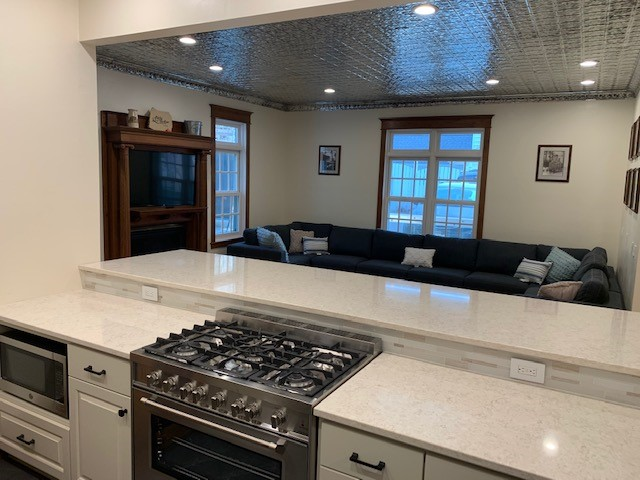 Huge propane oven grill with a huge granite kitchen island and fireplace!