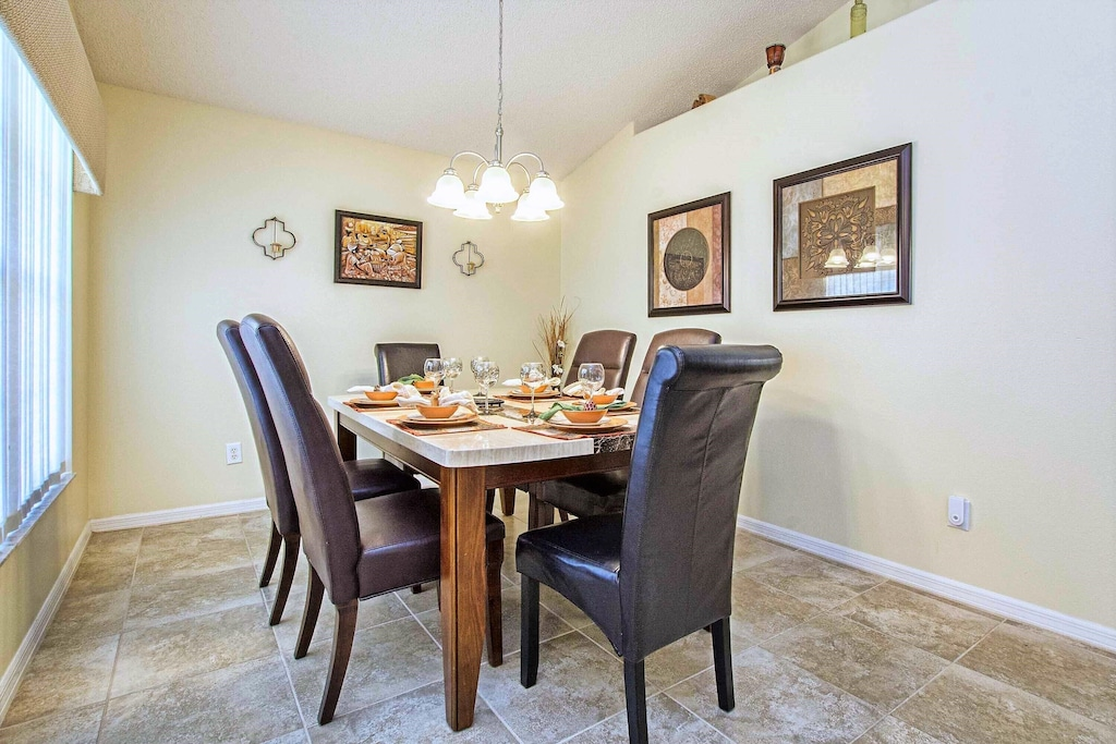 The formal dining room is separated from the living area but still open.