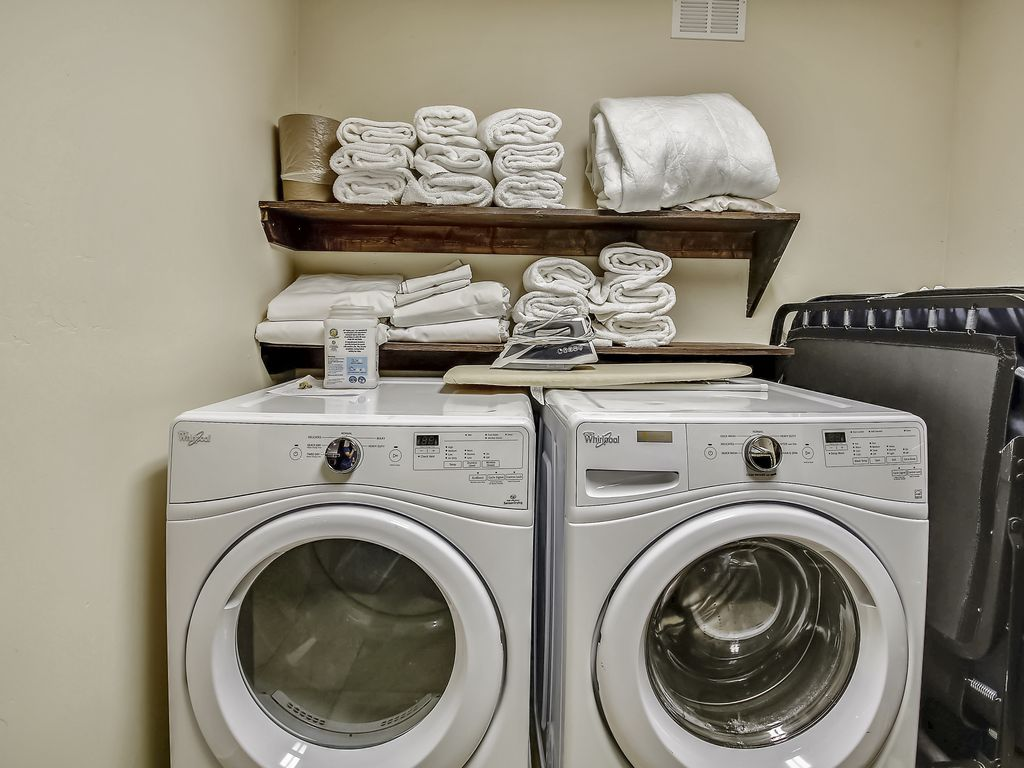 Laundry Room - Two laundry rooms.  2 High efficiency washers and 3 dryers
