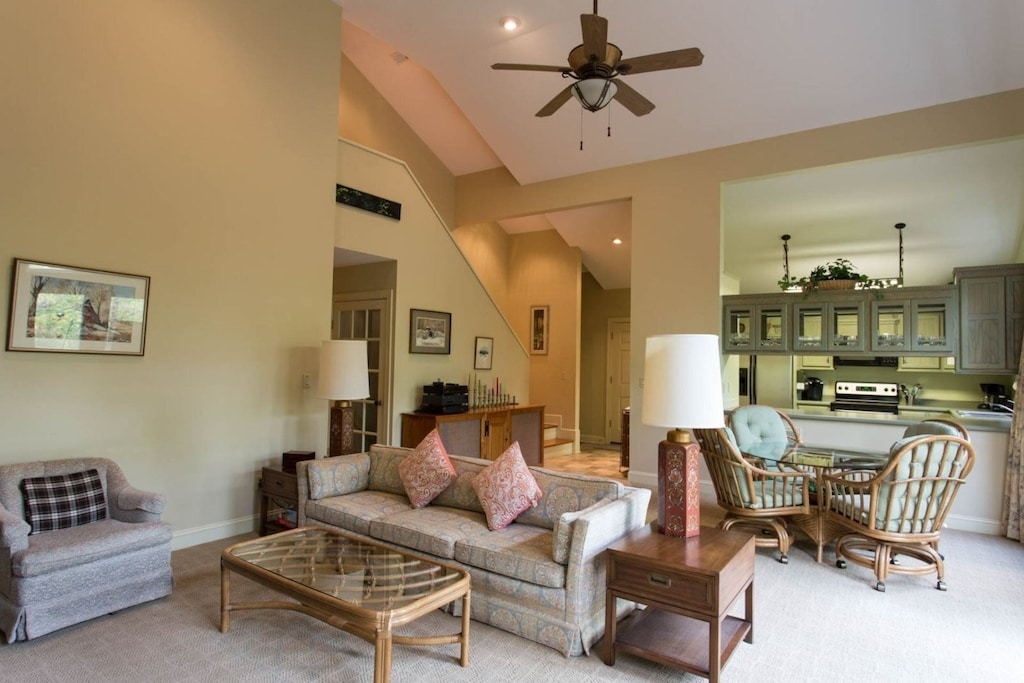 Past the dining area is the living area with comfortable furniture and a TV.