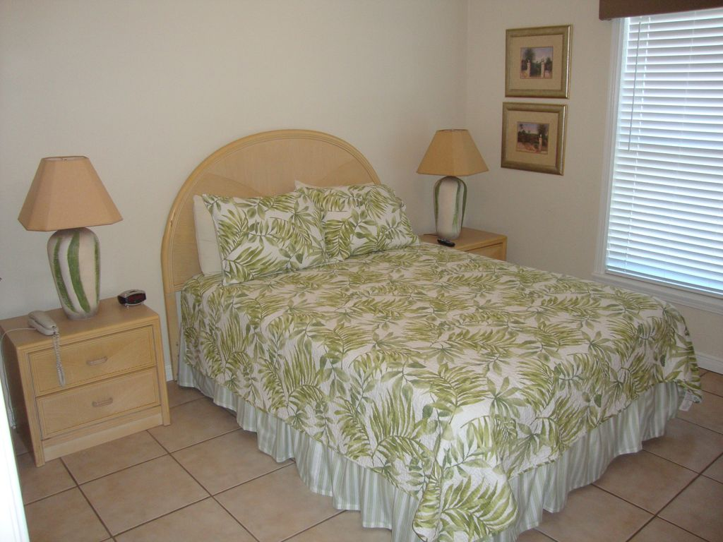 The second bedroom has queen bed and private access to the hall bath with shower
