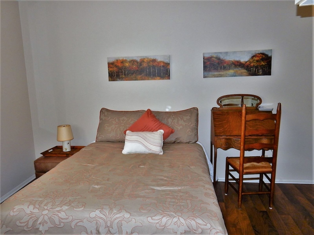 Additional view of upper level bedroom with full bed
