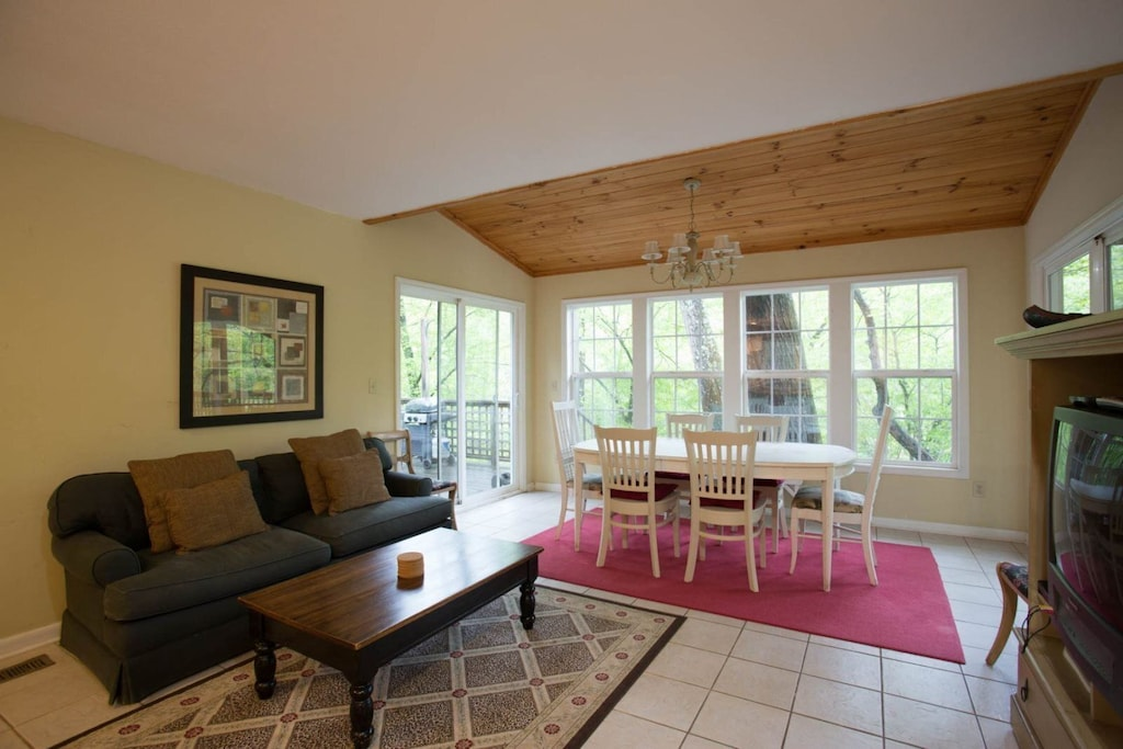Just beyond the kitchen is a family room area with a sofa and TV.
