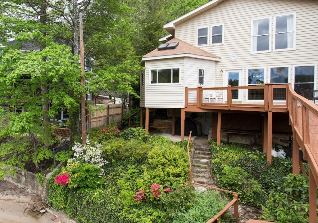 Notice the patio, below the house structure, with a swing and gas grill.