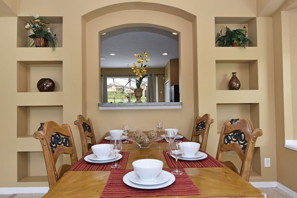 Dinning room with view of the kitchen and backyard