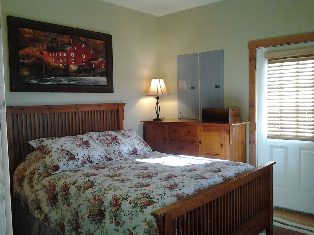 Lower level Queen Bedroom #4 - Access to outdoor middle level parking/ garage area