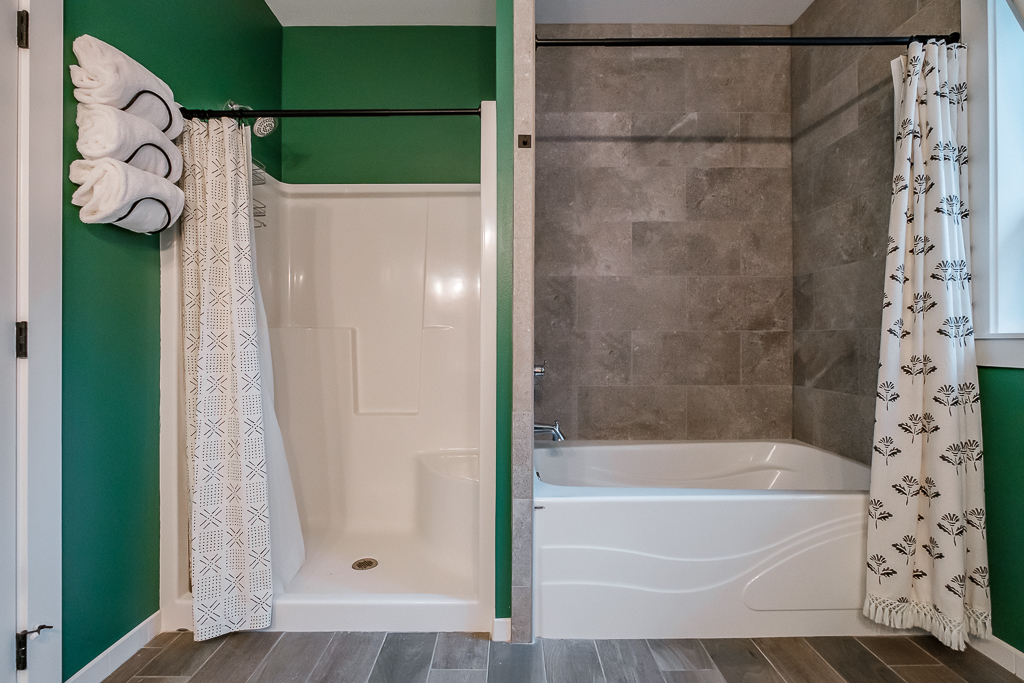 Rare double shower and bath in this suite.