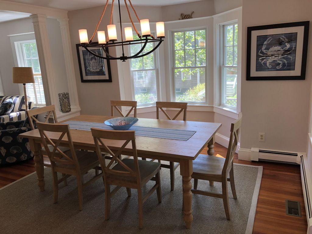 Bright and sunny dining room with new table, chairs and buffet.