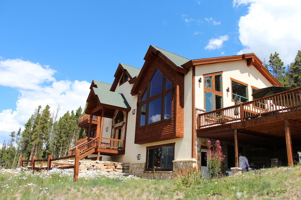Front of home - private deck in the center of 5 acres. 3 levels all with amazing views