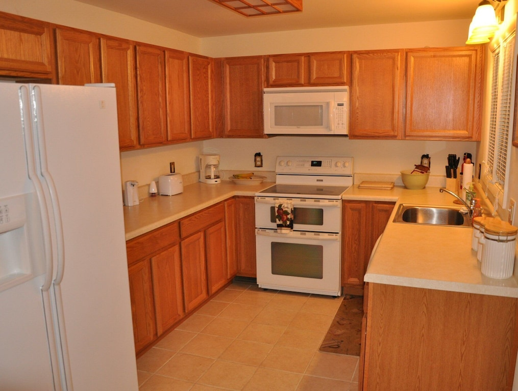 Full kitchen including a dishwasher