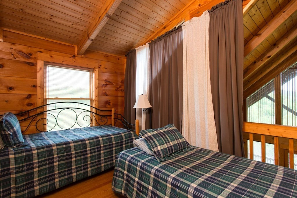 On the loft is a day bed and twin bed. You can close a curtain for privacy.