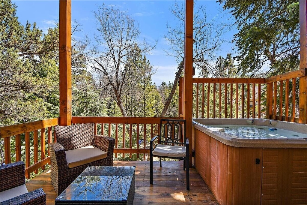 Private deck with hot tub and seating for family and friends.