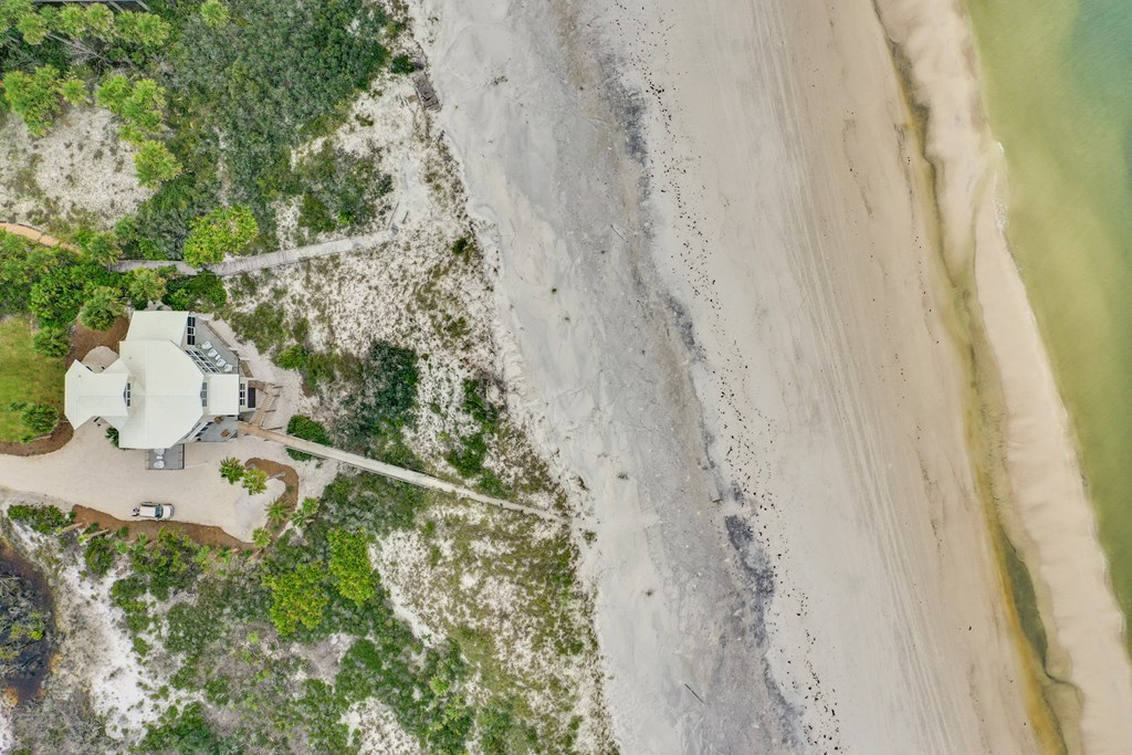 Aerial of house showing boardwalk and beach