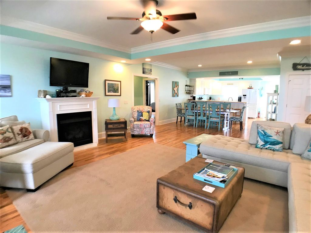 Family room with comfortable seating and gas fireplace!