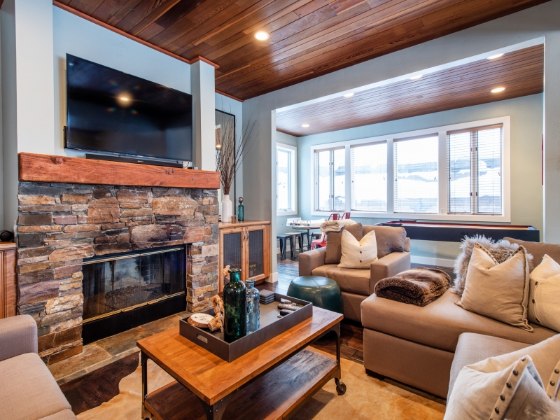 Cozy living space. Instant gas fire, smart TV and large kids games area set to the side. Beautiful views into the woods.