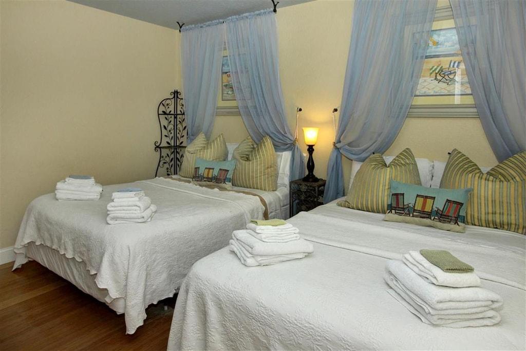 Designer Guest Bedroom with Elegant Canopied Beds, 1 Queen and 1 Full