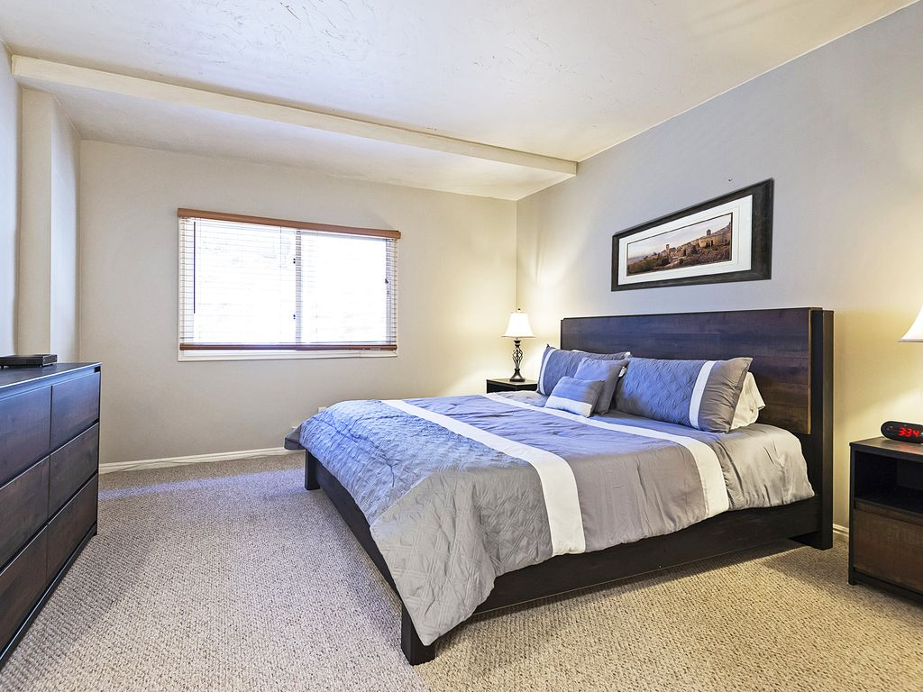 Master bedroom with king bed, TV and ensuite bath