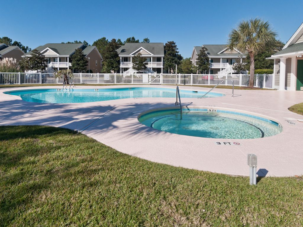 Take a dip in the pools or soak in the hot tub, just steps from the front door
