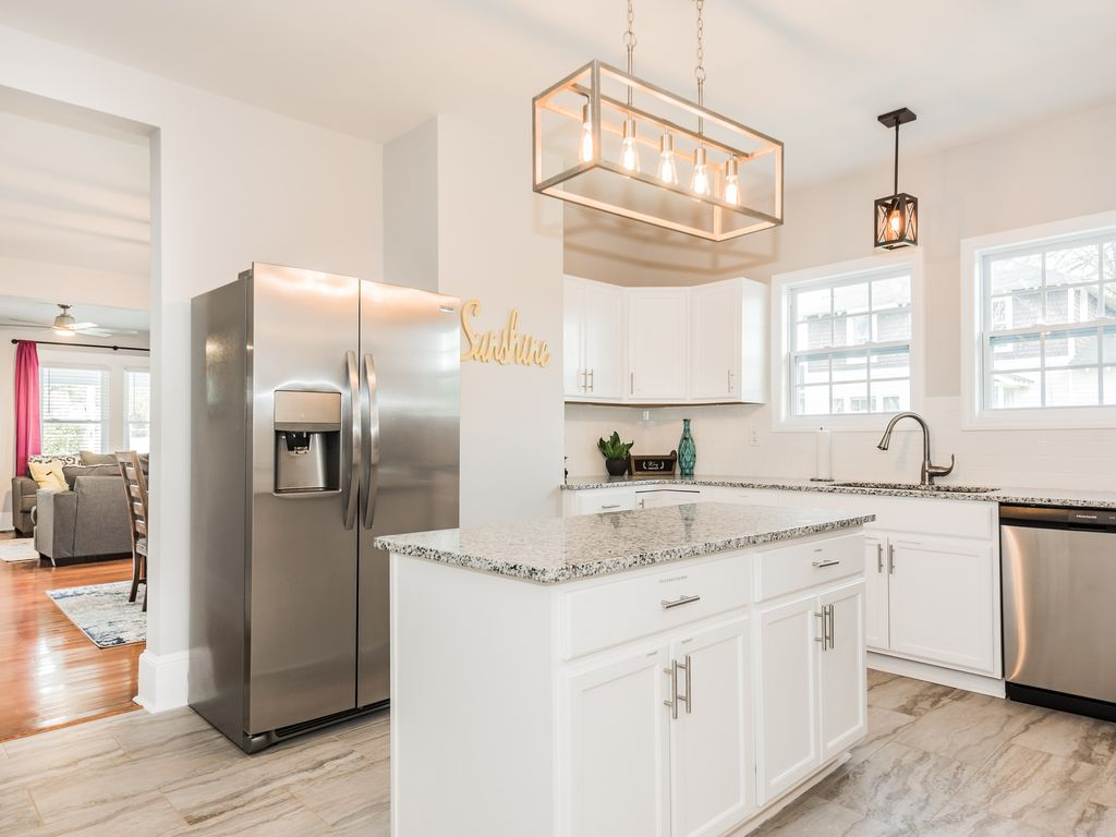 Kitchen with fridge, dishwasher, stove, microwave, toaster, K-Cup machine.